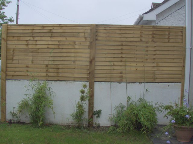 Overlap Panels on Top of Wall fitted on Battens expressed bolted to wall