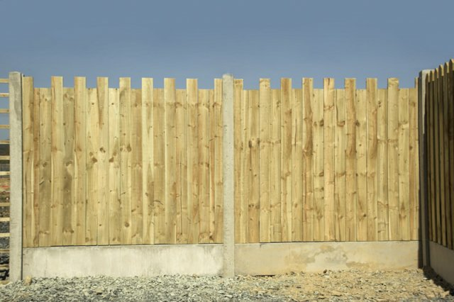 Castle Style Closed Picket Panels in Concrete Posts and with Gravel Boards