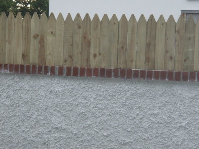 Pointed Top Closed Picket fitted on Timber Battens attached to Wall - Shankill